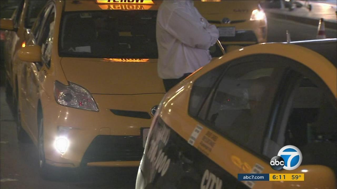 File photo of taxis at Los Angeles International Airport.