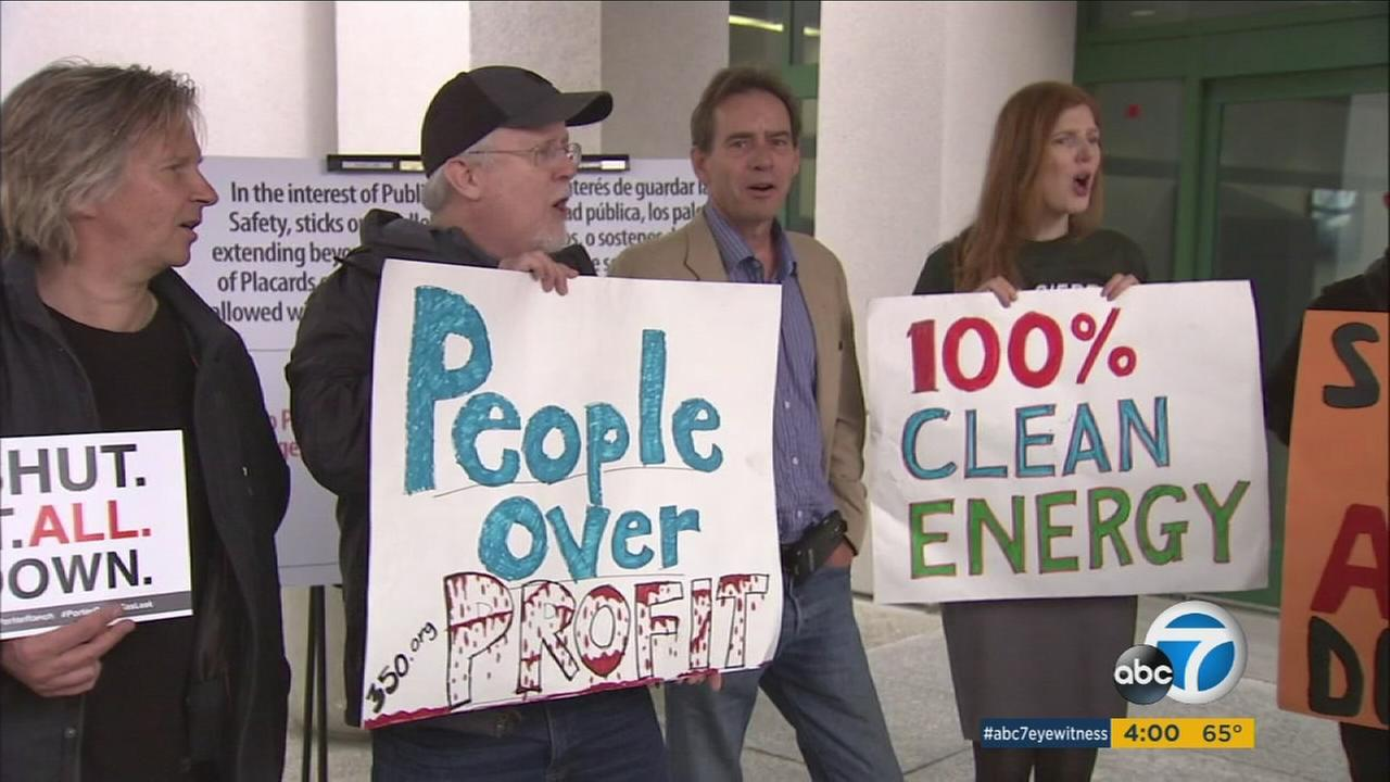 Residents hold up signs demanding the shut down of the Aliso Canyon gas storage facility where the months-long leak is on Wednesday, Jan. 20, 2016.