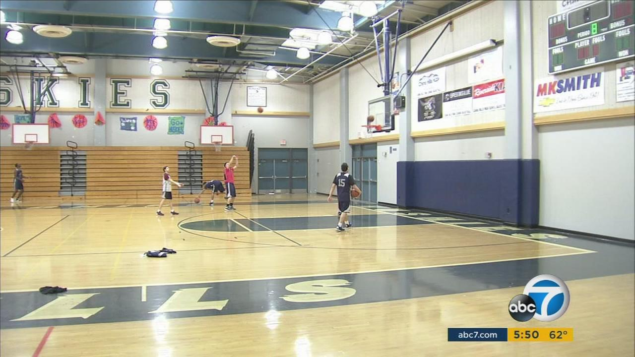Players practice basketball at Chino Hills High School.