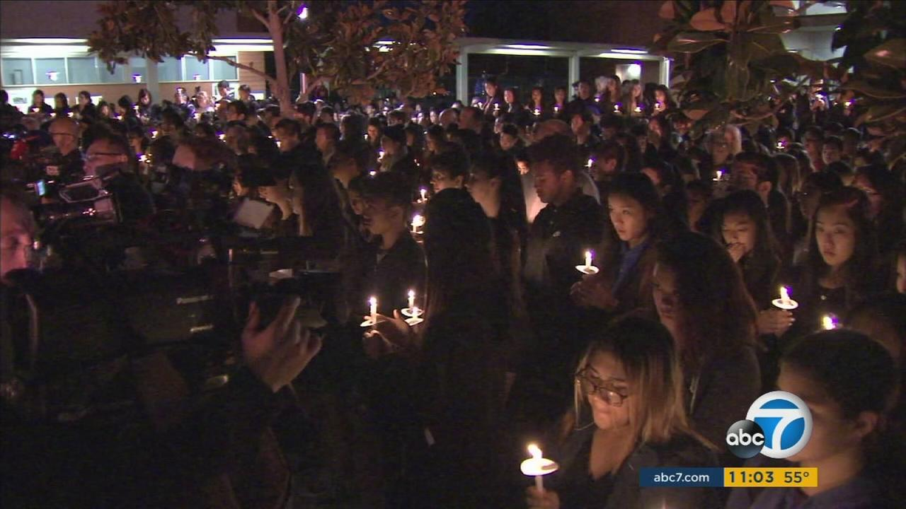 More than a thousand people held a tearful candlelight vigil in Arcadia for two teenage brothers who were brutally beaten to death in their home.