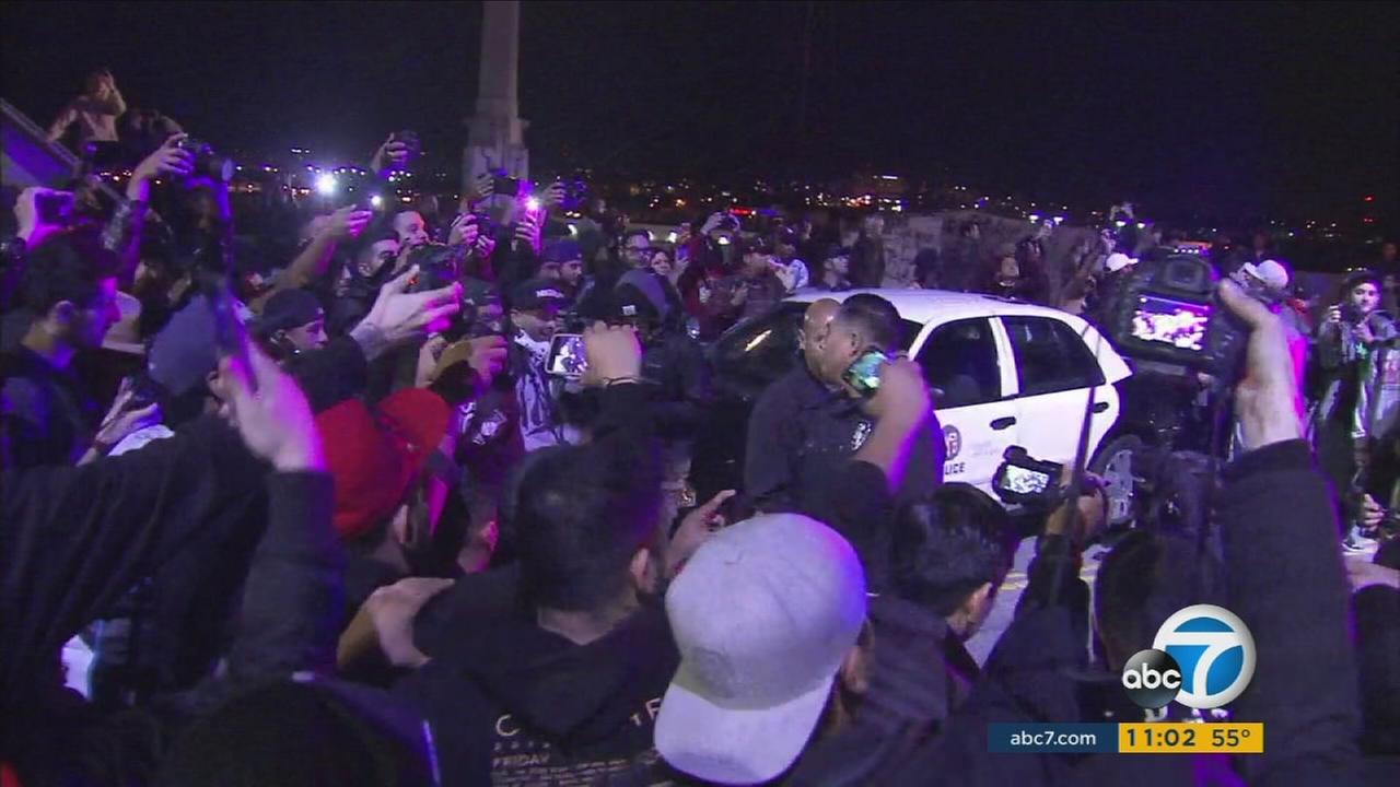 A large crowd gathered on the historic Sixth Street Bridge in downtown Los Angeles Tuesday night, according to Los Angeles police.