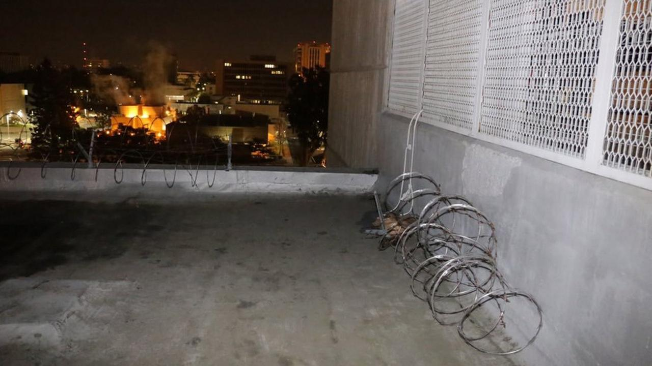 A photo shows the barbed wire that was cute on the roof of the Orange County Central Mens Jail where three inmates escaped.