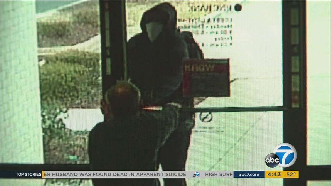 A North Carolina bank manager is shown thwarting an attempted robbery at his branch.