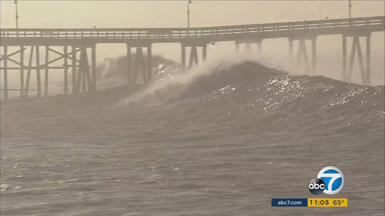 A large wave pummels the Ventura Pier as a storm creates high surf along the Southern California coast on Friday, Jan. 29, 2016.