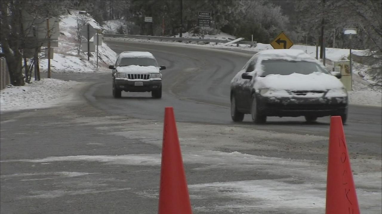 Cars drive through mountain communities in San Bernardino County on Monday, Feb. 1, 2016, following a burst of El Nino-fueled snow.