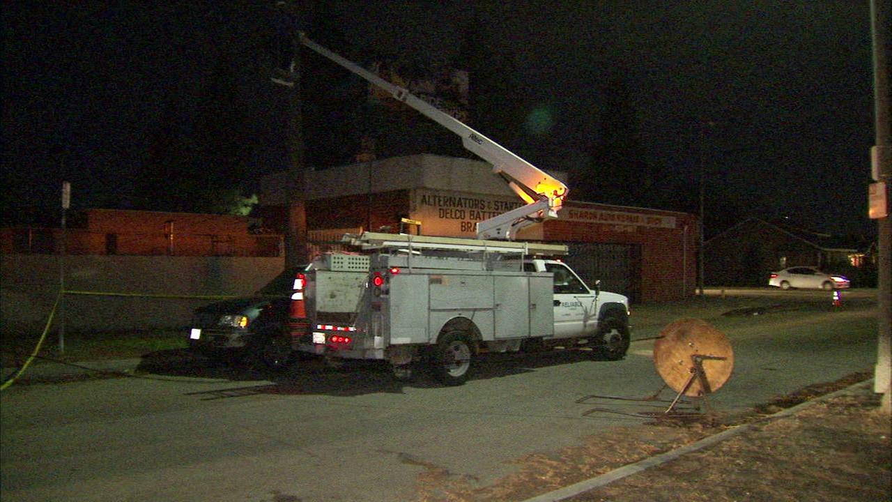 Power crews work to restore electricity following a weekend storm fueled by El Nino.