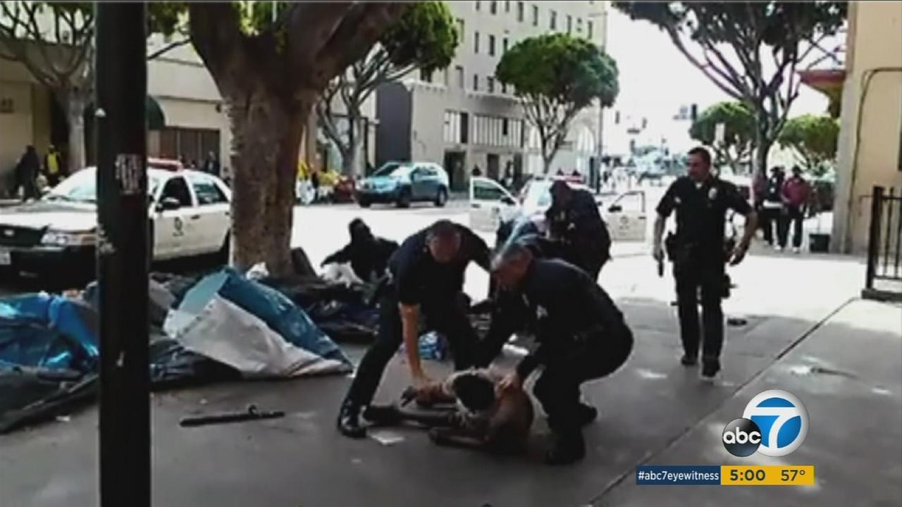A witness captured cellphone video of Los Angeles Police Department officers shooting a homeless man on Skid Row after a fight on March 1, 2015.