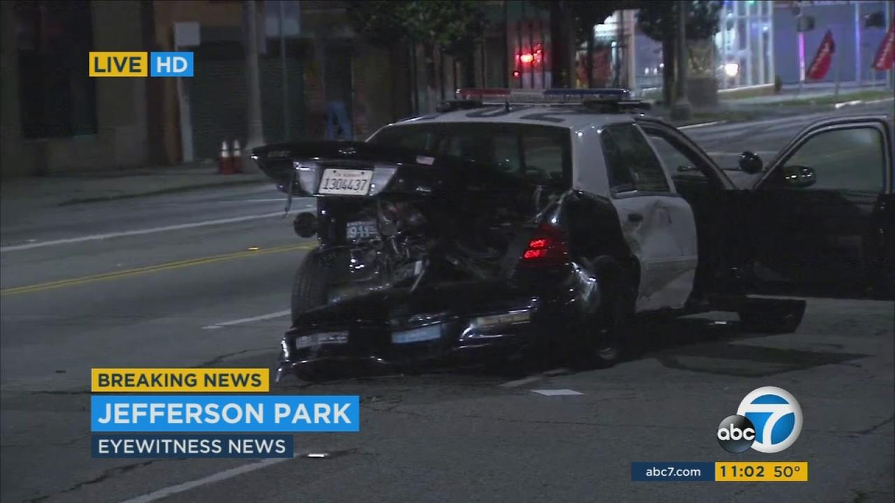 Two Los Angeles police officers were injured in a three-car crash at Crenshaw and Exposition boulevards in Jefferson Park while responding to a pursuit on Tuesday, Feb. 2, 2016.