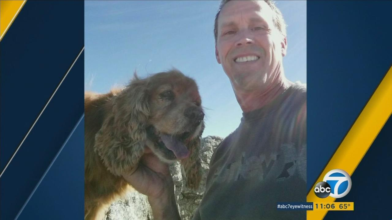 Mike Heredia poses with his 15-year-old cocker spaniel Otis who he said was stolen in Claremont on Sunday, Feb. 7, 2016.