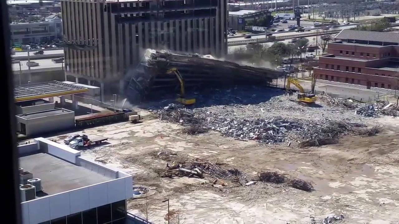 A still image shows the demolition of a Texas corporate plaza in Houston on Tuesday, Feb. 10, 2016.