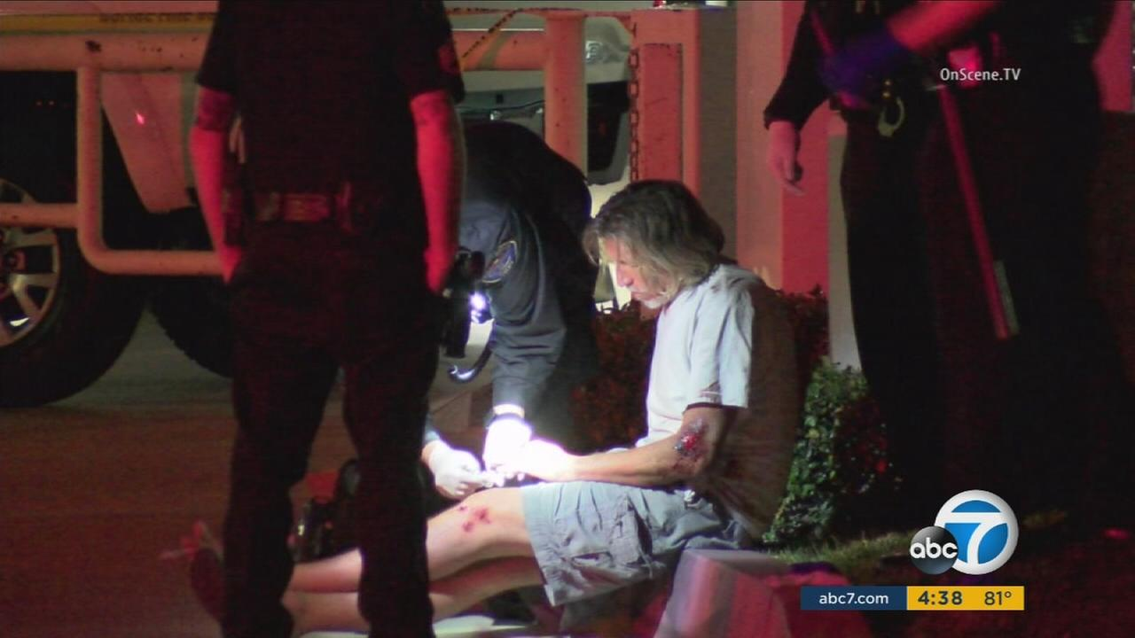A father and son have been arrested for assaulting a Huntington Beach officer.