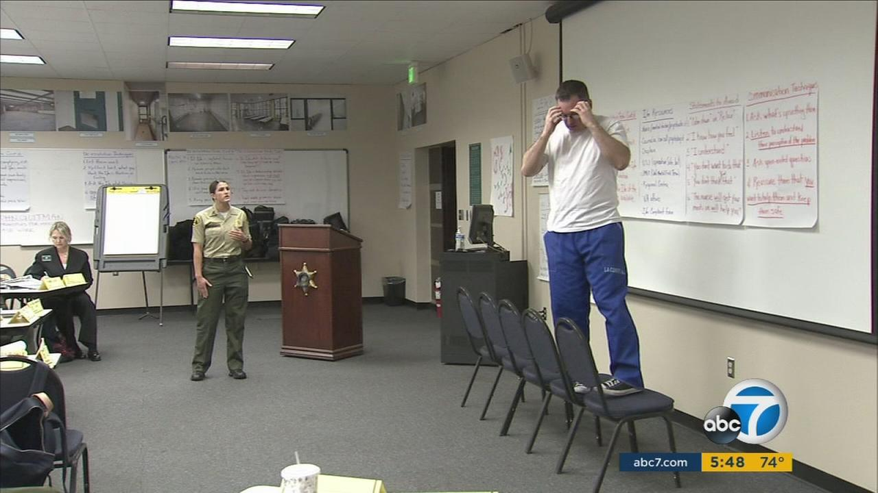 Los Angeles County Sheriffs Department Deputy Bria Beardsley participates in a training exercise to handle mentally-ill inmates in this photo.