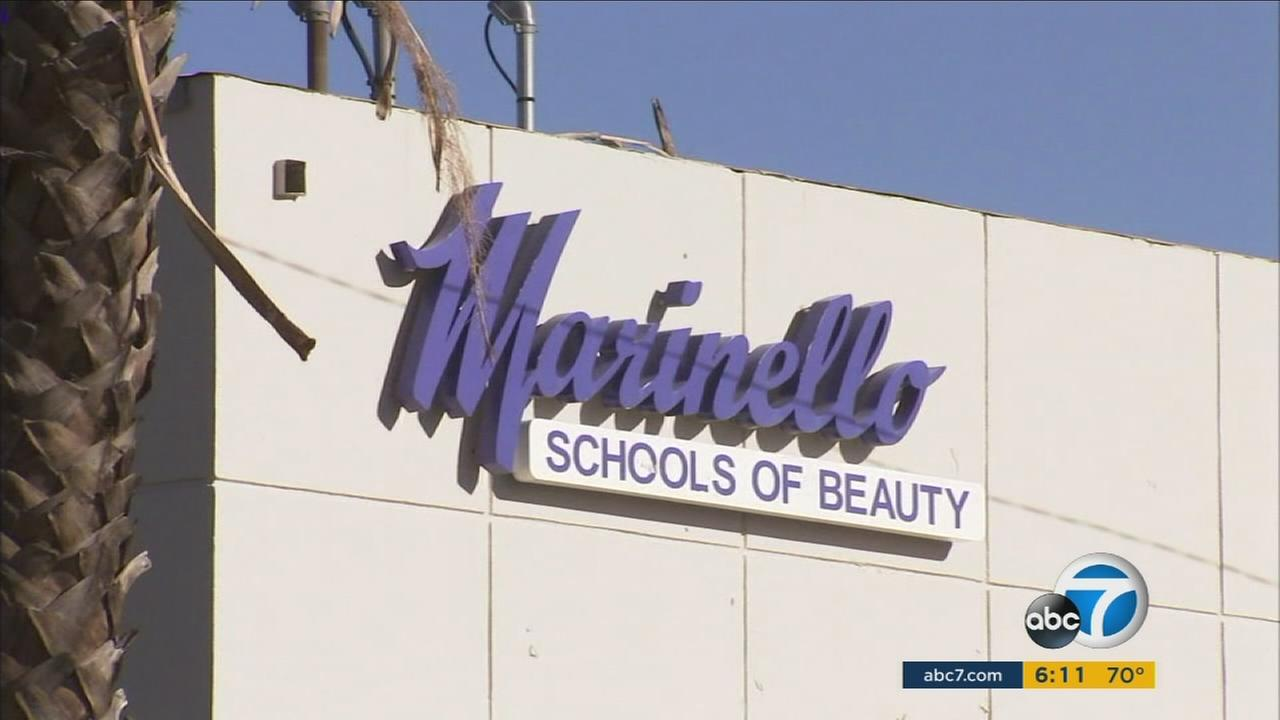 A security guard can be seen securing the front door of the Marinello  Schools of Beauty