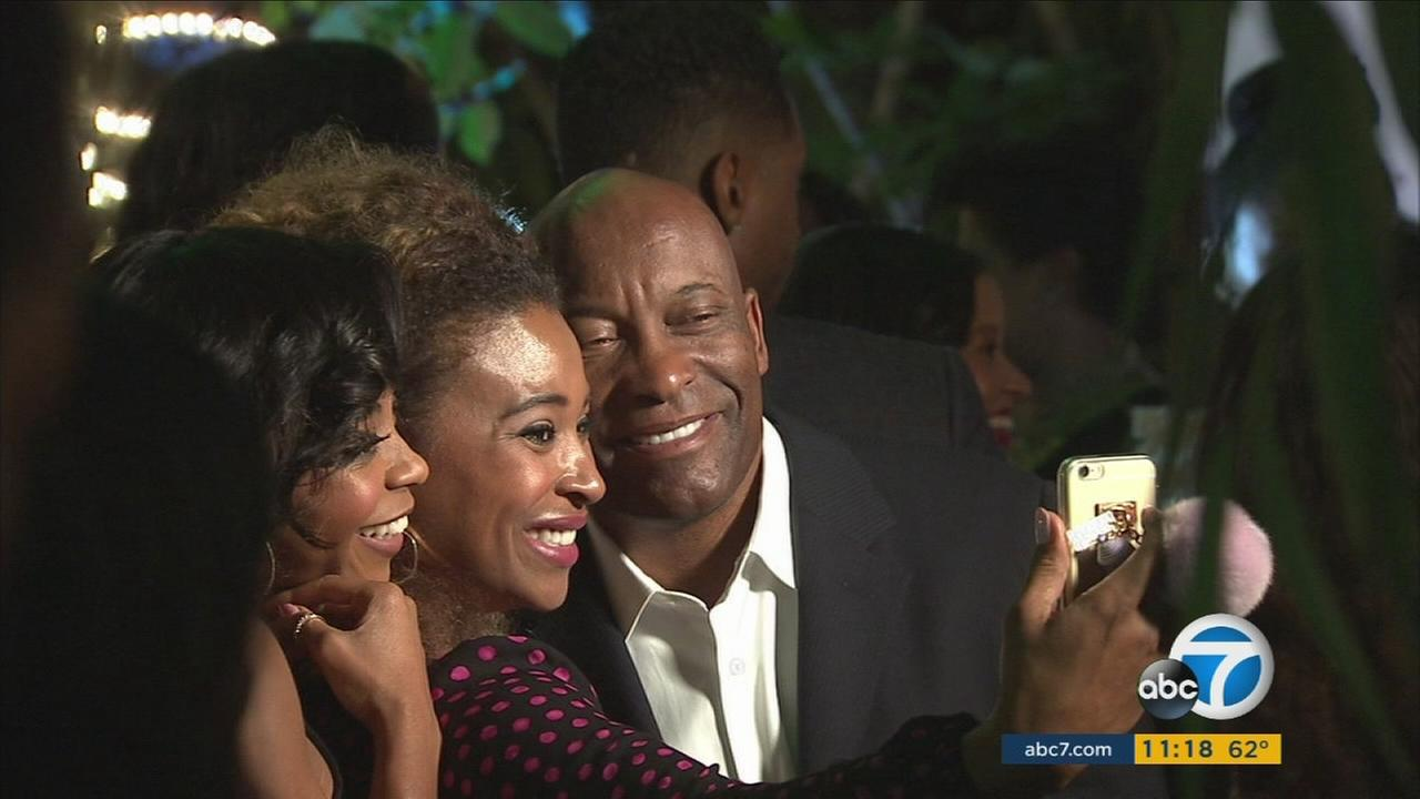 Director John Singleton (right) poses for a picture at the seventh African American Film Critics Association Awards on Wednesday, Feb. 10, 2016.