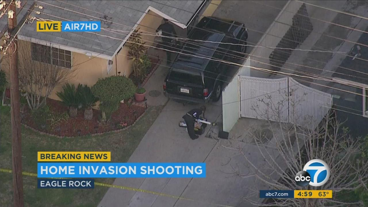 A man was shot and a woman was pistol-whipped in an Eagle Rock home invasion.