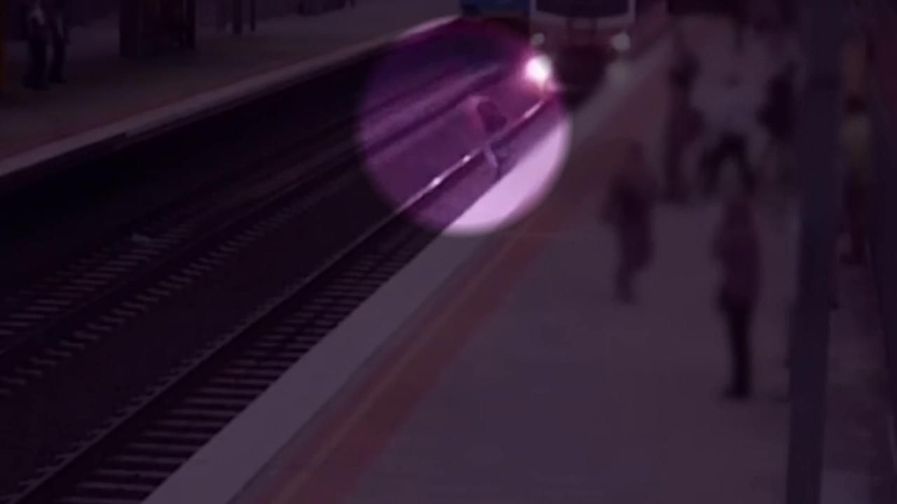 A man trying to take a short cut across the subway tracks nearly got struck by a train in Melbourne, Australia.