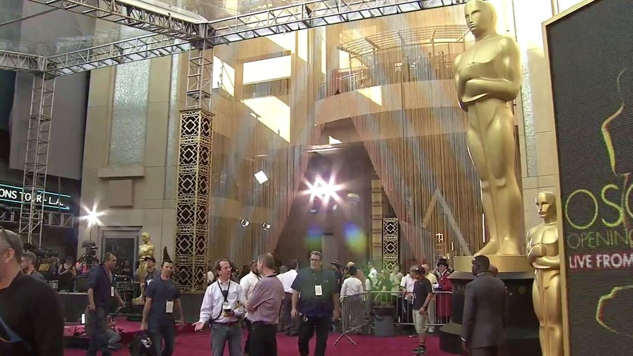 Crews work on last minute preparations at the Oscars red carpet on Saturday, Feb. 27, 2016.