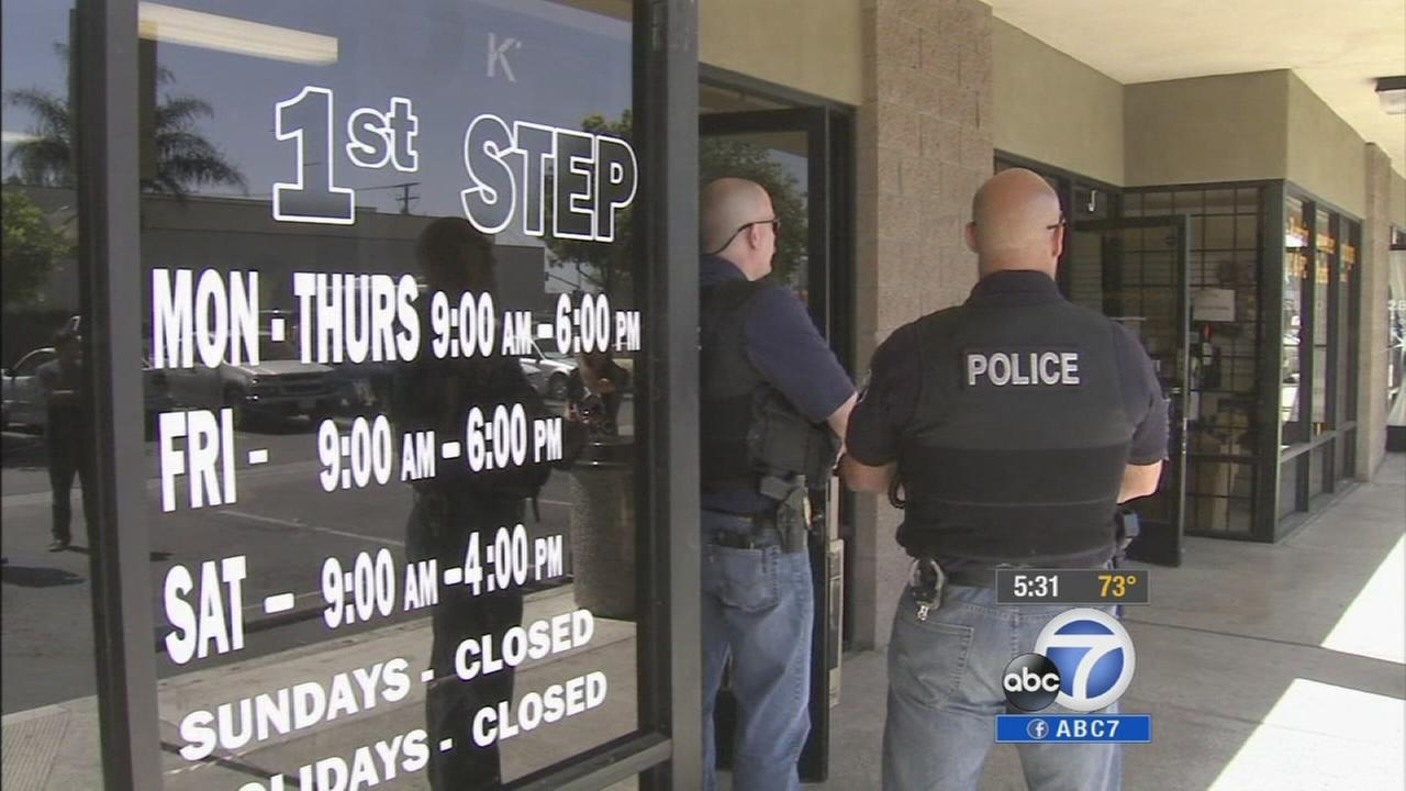 Santa Ana police stand outside First Step Rentals, a business accused of scamming people out of hundreds of dollars, on Wednesday, June 18, 2014.