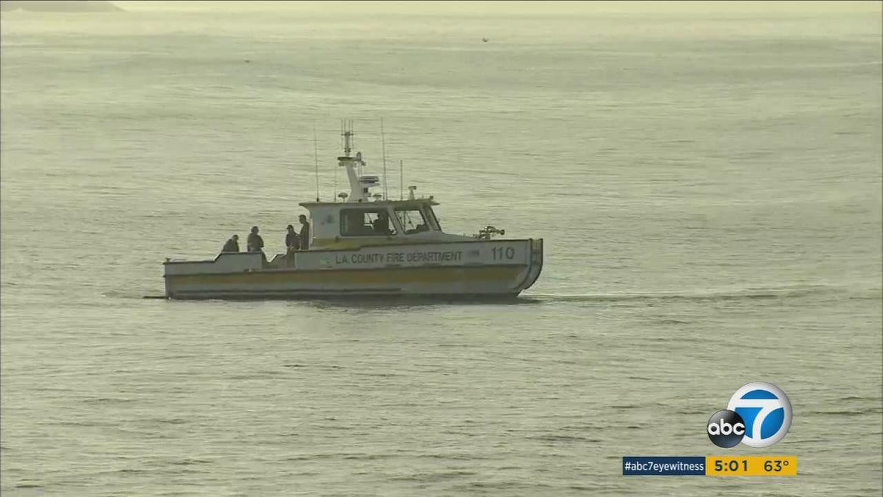 A search was suspended for a reported missing swimmer near the Santa Monica Pier on Sunday.