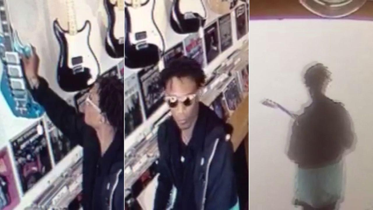 A suspect is seen in surveillance still images taking a guitar from Caveman Vintage Music in Chinatown on Saturday, March 12, 2016.