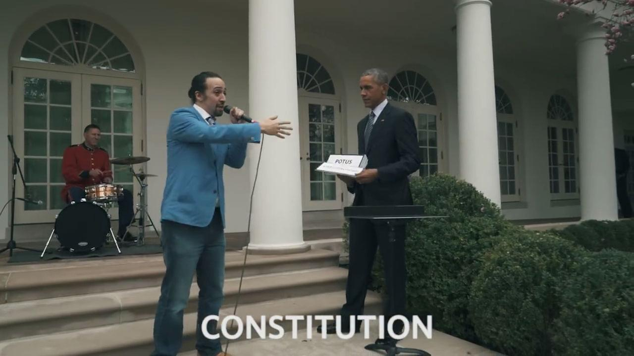 Hamilton star and creator Lin-Manuel Miranda raps to cue cards held up by President Barack Obama at the White House.