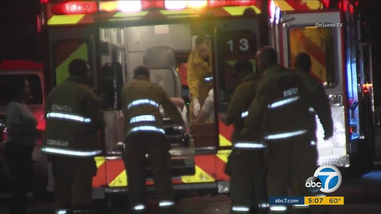 A woman and her 16-year-old daughter were shot after a confrontation with gang members at a bus stop in Pico-Union.