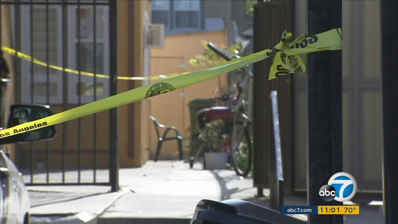 Crime tape is set up near the scene of a fatal shooting in the 500 block of Virgil Avenue in Los Angeles on Tuesday, April 12, 2016.