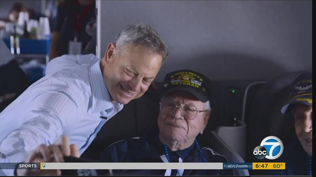 Gary Sinise is shown taking a selfie with a veteran who is part of the Soaring Valor program that takes vets to the New Orleans WWII museum.