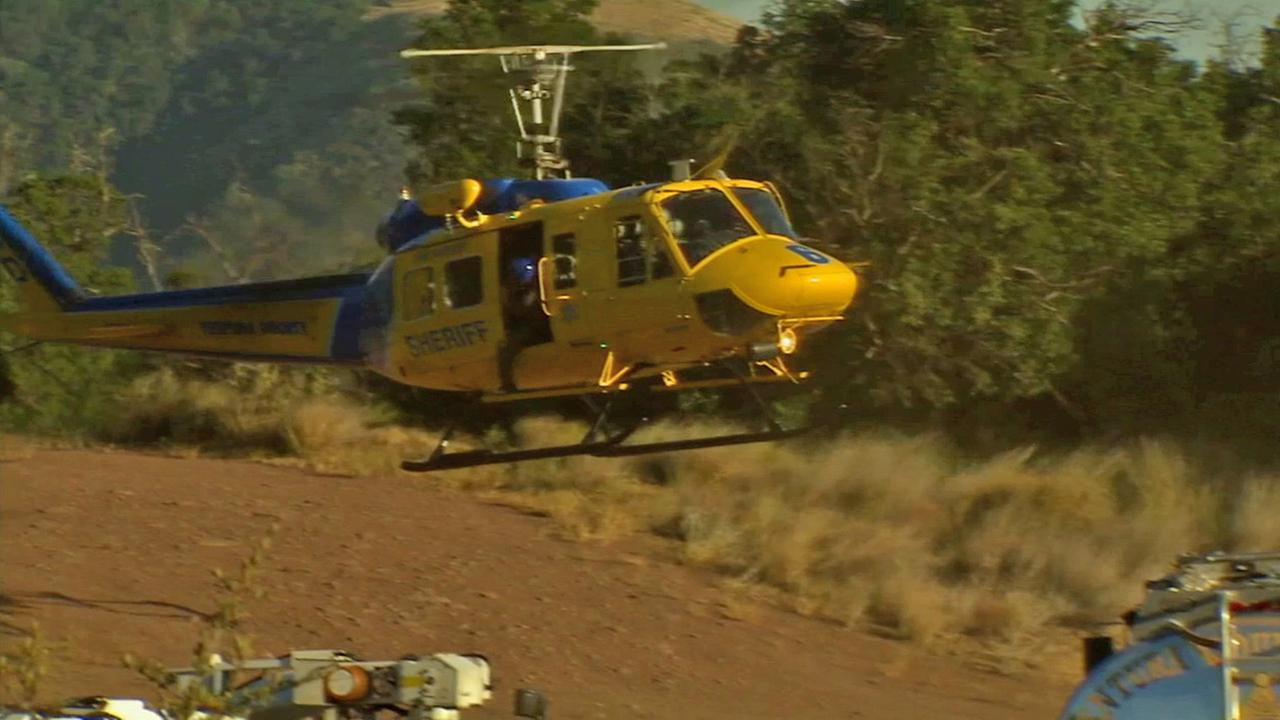 A sheriffs helicopter is seen during a search for missing firefighter Mike Herrera on Friday, June 20, 2014.