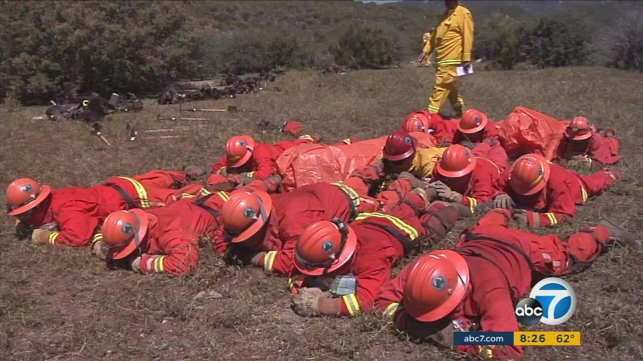 The states voluntary inmate firefighter program is training crews to fight flames on rough, dangerous terrain.