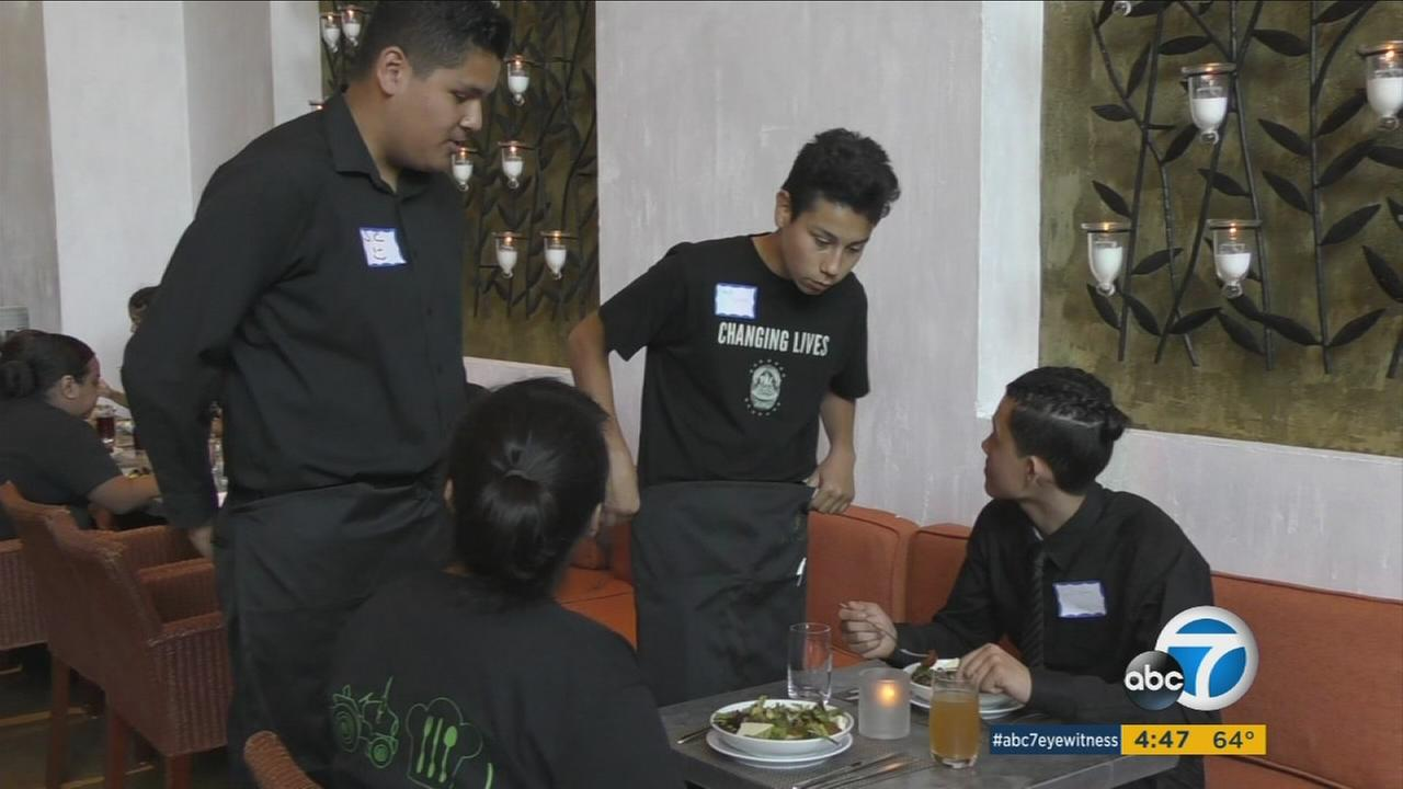 A program started by the owner of Fig and Olive restaurant helps kids from low-income neighborhoods learn cooking and restaurant skills.
