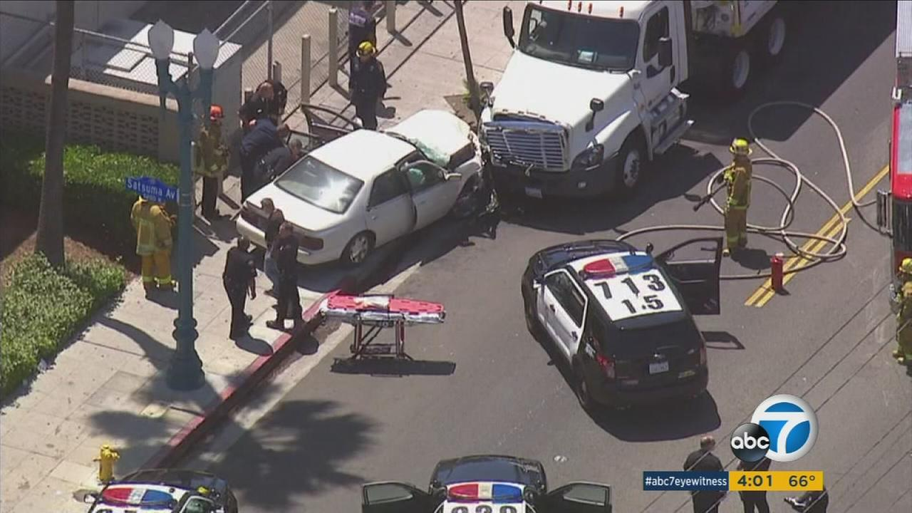 A suspect died - possibly of a self-inflicted gunshot wound - after a short police chase ending when the vehicle crashed in North Hollywood, police said.
