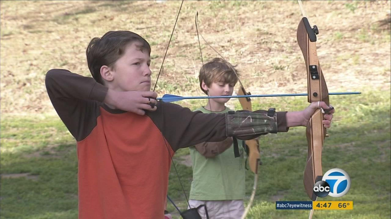 Kids learn archery during a free session at the YMCA.