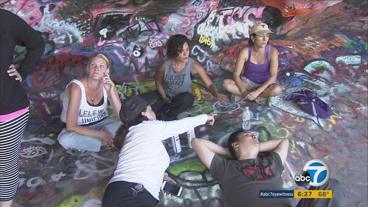 A group of people who tried to tag up the Jim Morrison Cave are shown in an undated photo.