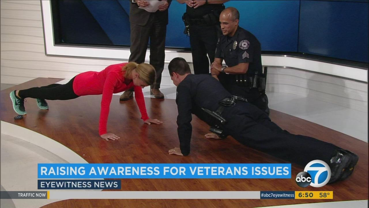 ABC7 meteorologist Bri Winkler completes the 22KILL pushup challenge with Azusa Police Chief Sam Gonzalez.