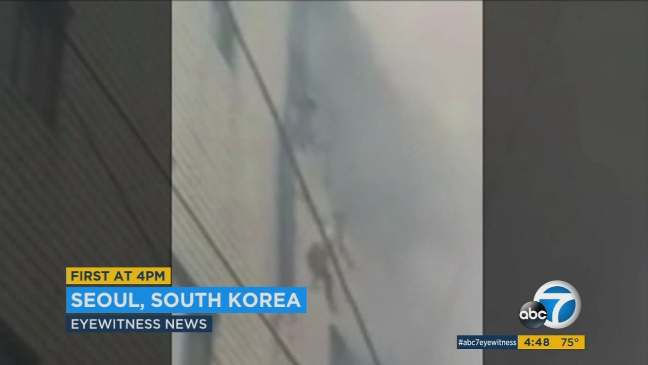 Video captured a dramatic rescue from a South Korea fire, as U.S. Army personnel caught kids dropped from a four-story window.