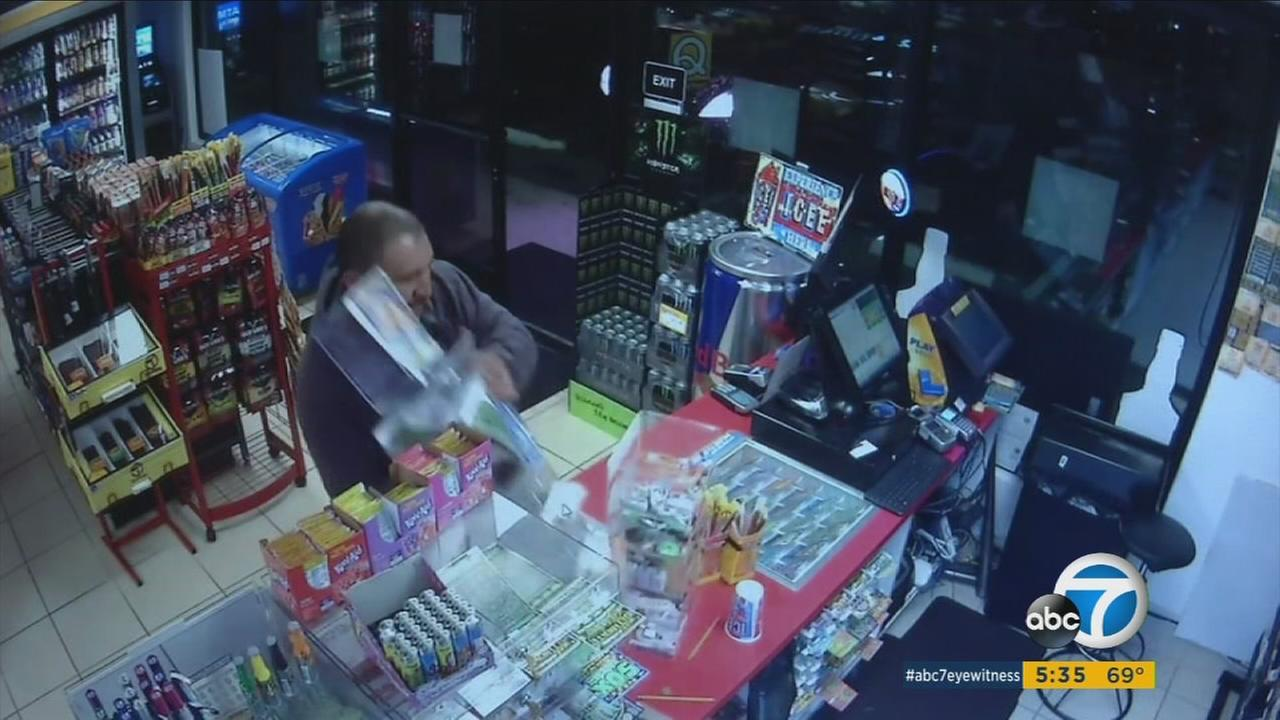 Two men are suspected of grabbing lotto cases off convenience store counters and cashing in thousands of dollars in stolen tickets.