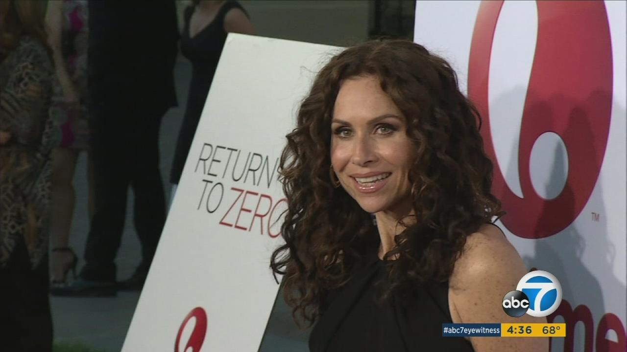 Actress Minnie Driver has taken out a restraining order against a 74-year-old neighbor over an ongoing property dispute.