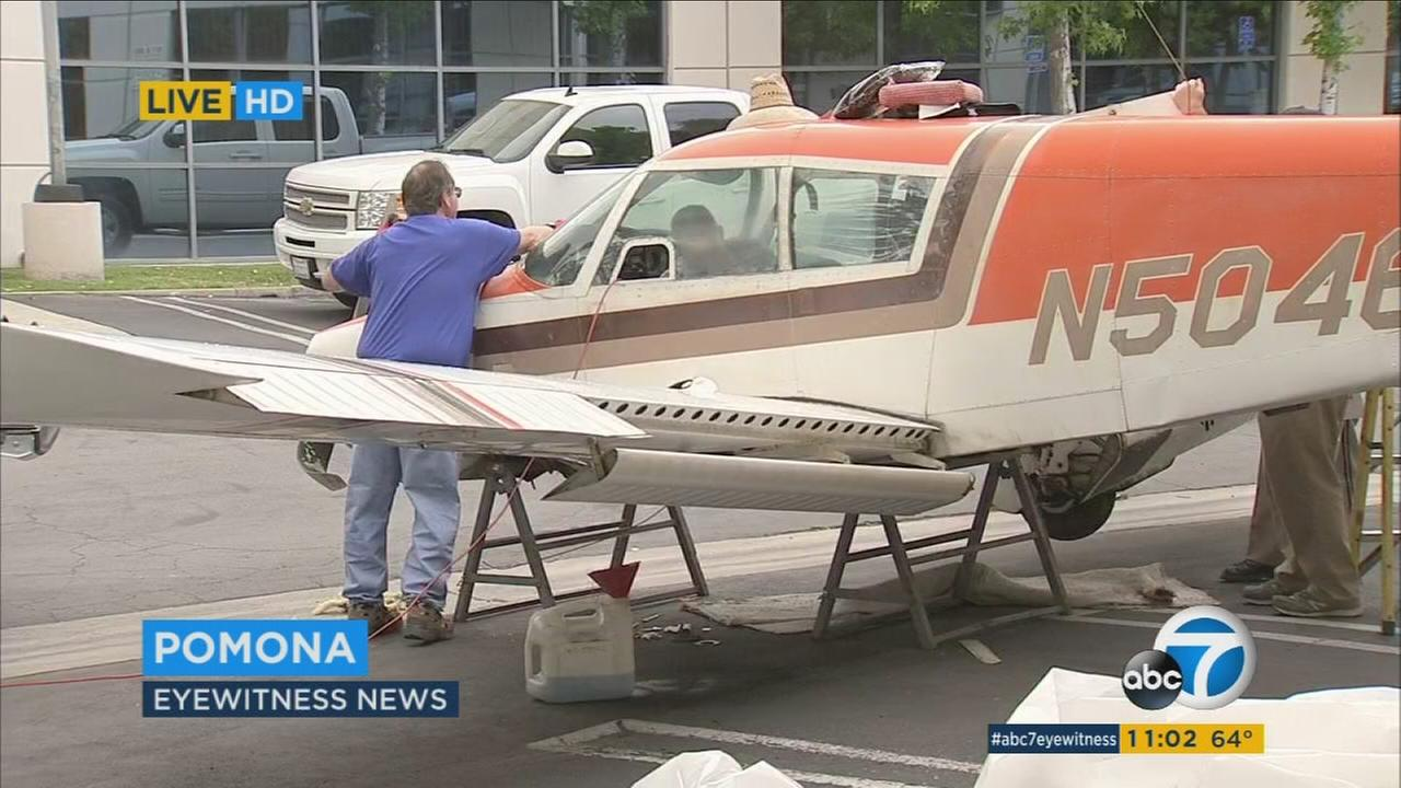 Small plane lands on top of Pomona building