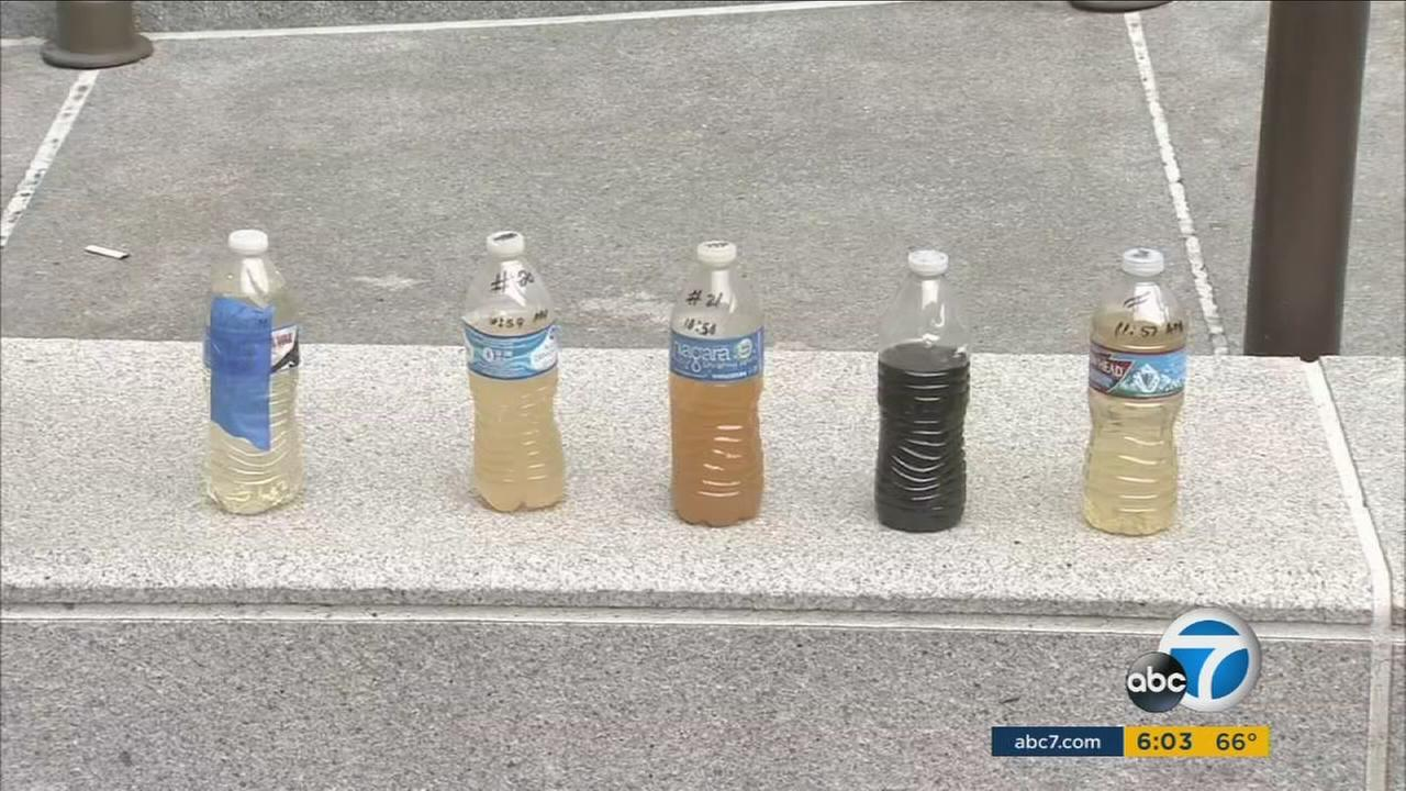 The LA Department of Water and Power is trying to find out why water flowing from pipes in Watts is discolored brown and yellow.