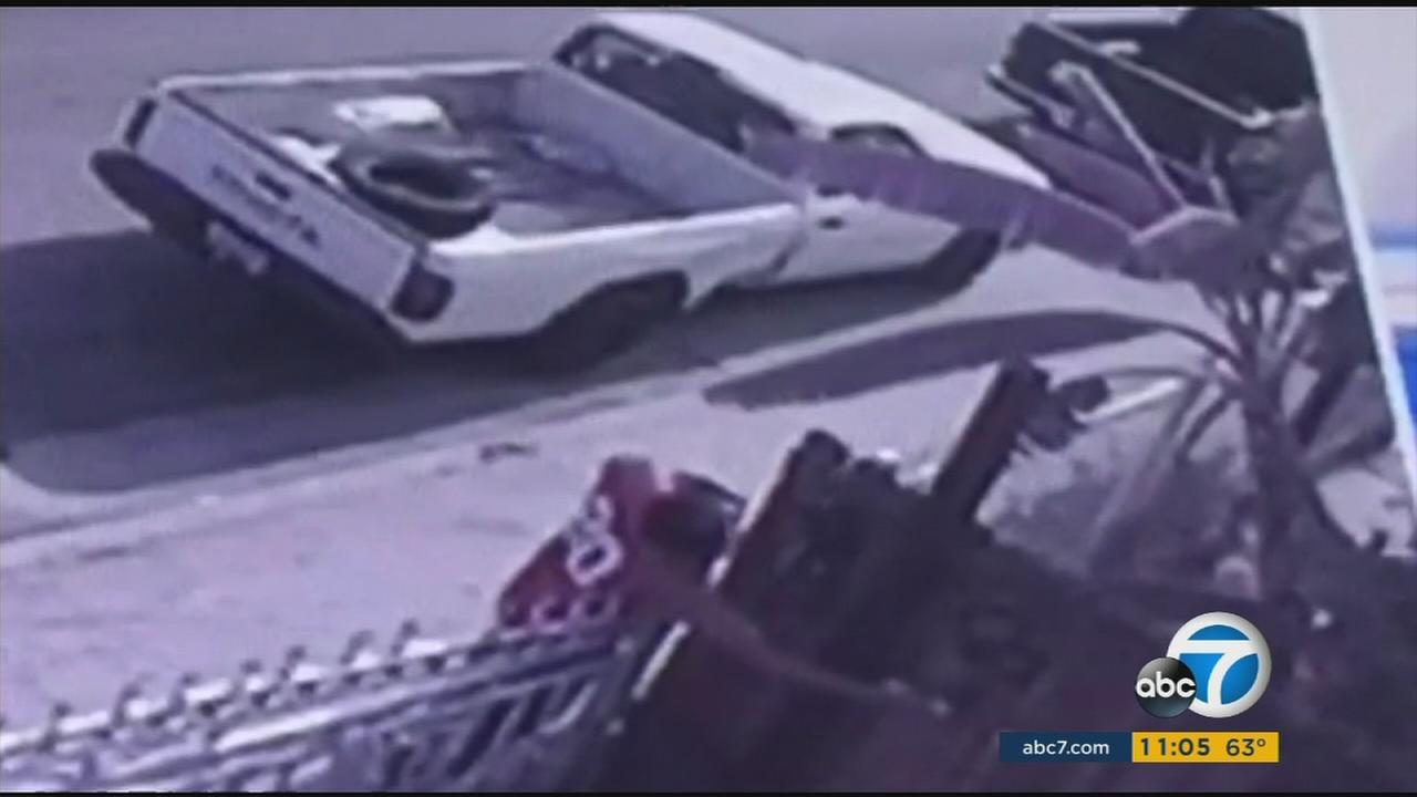 A suspect is caught on camera tagging a fence in South Los Angeles in this undated photo.