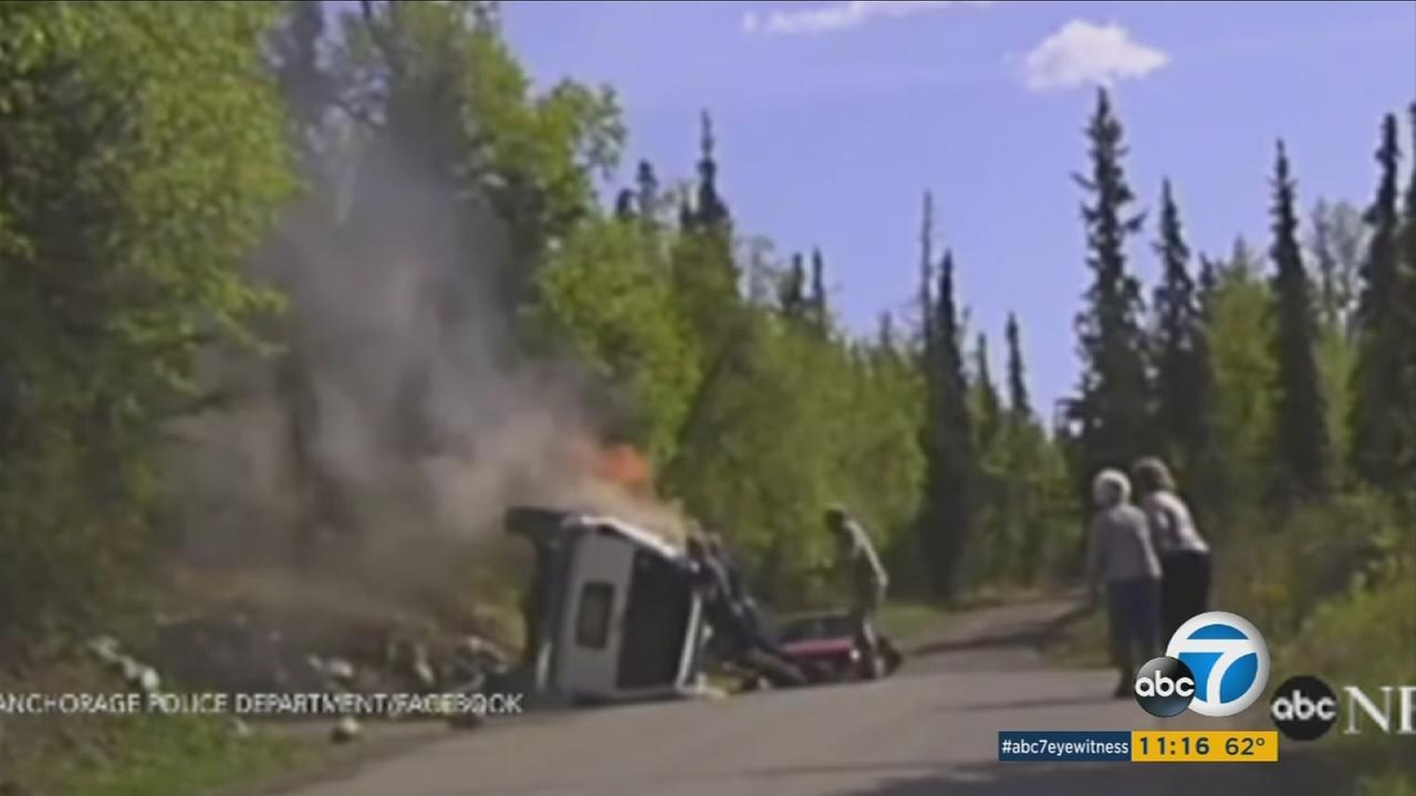 A man is rescued after having his arm pinned under a burning SUV in Anchorage, Alaska.