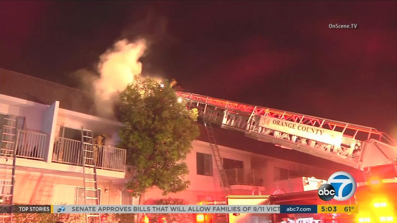 Firefighters rescue senior citizens trapped in a burning apartment building in Anaheim on Tuesday, May 17, 2016.