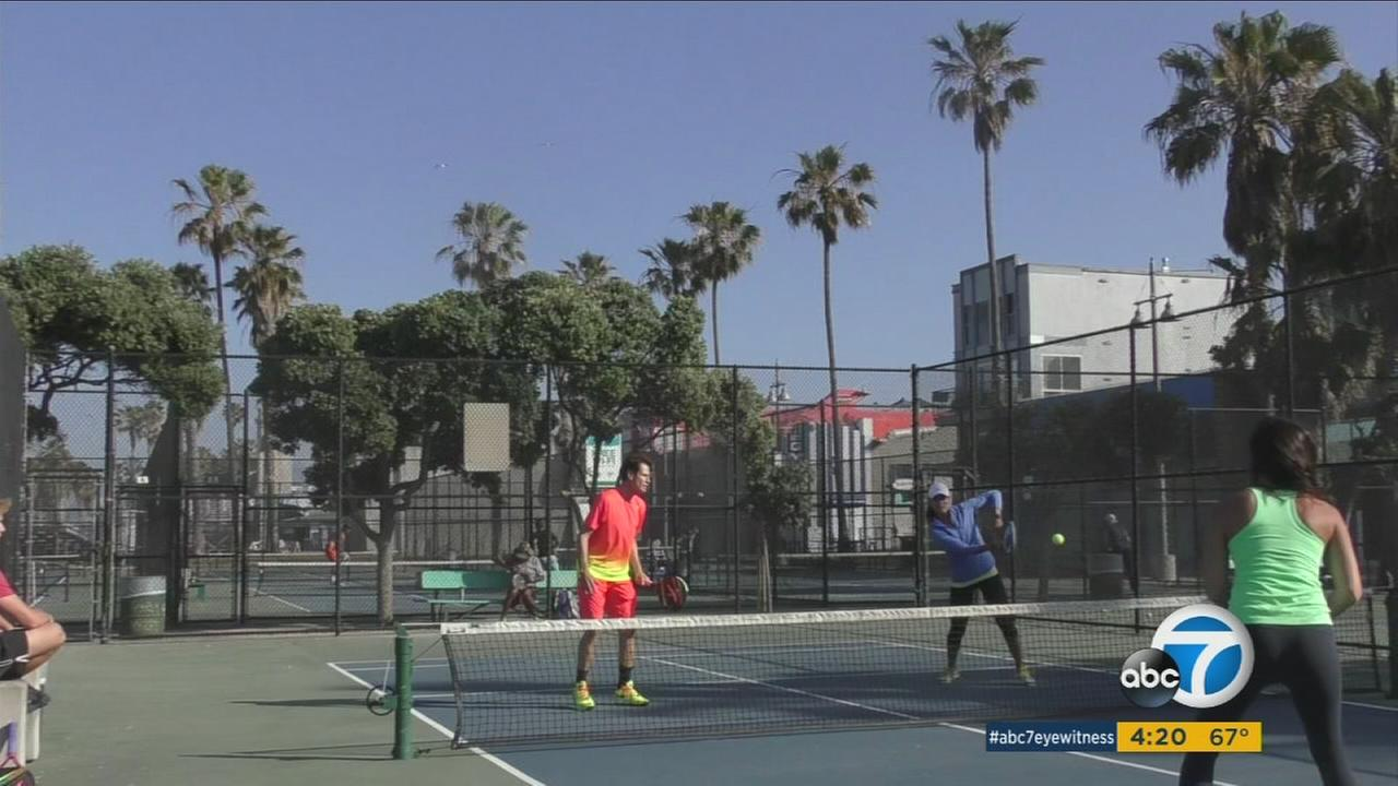 People playing tennis at a court in Santa Monica are shown in an undated photo.