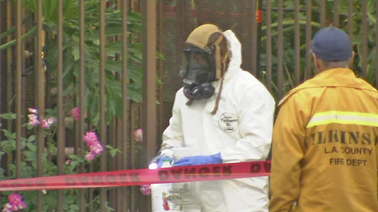 Authorities remove evidence from an apartment in Van Nuys after a possible drug lab was found Monday, June 23, 2014.