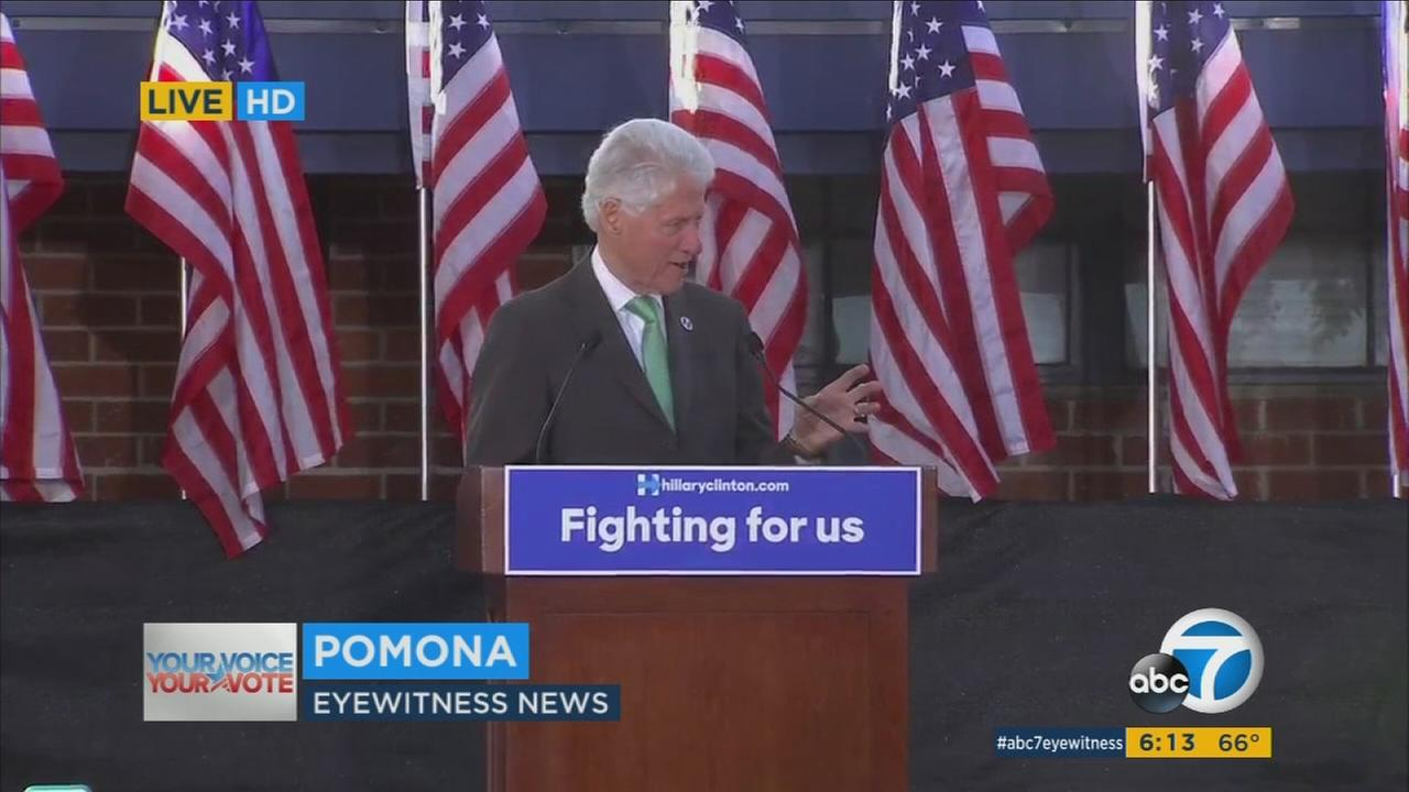 Former President Bill Clinton was interrupted by protesters at a Pomona high school, but said he welcomes dissenters because This is not a Donald Trump rally.
