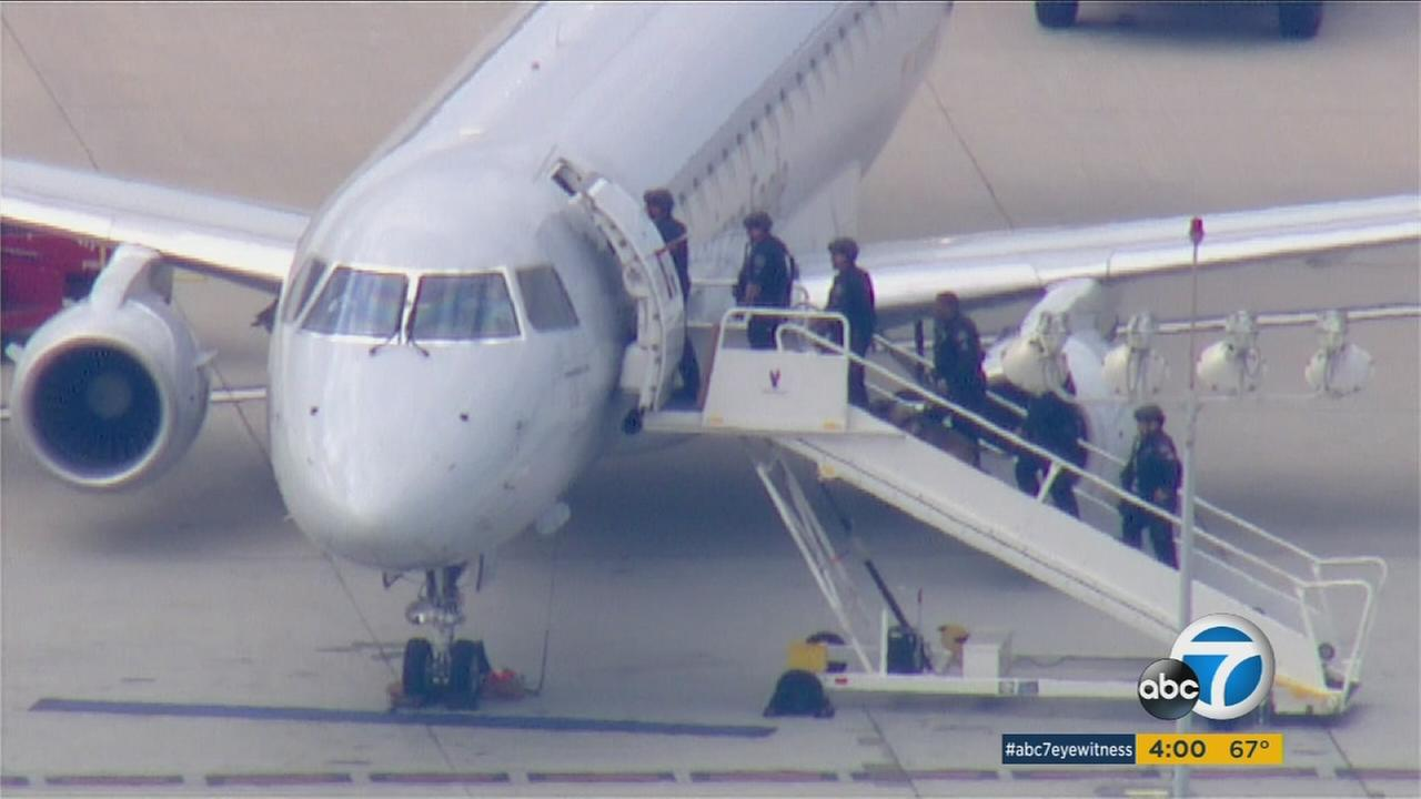 A phone call warning that a bomb was onboard a jetliner heading for LAX triggered a major response Tuesday morning.