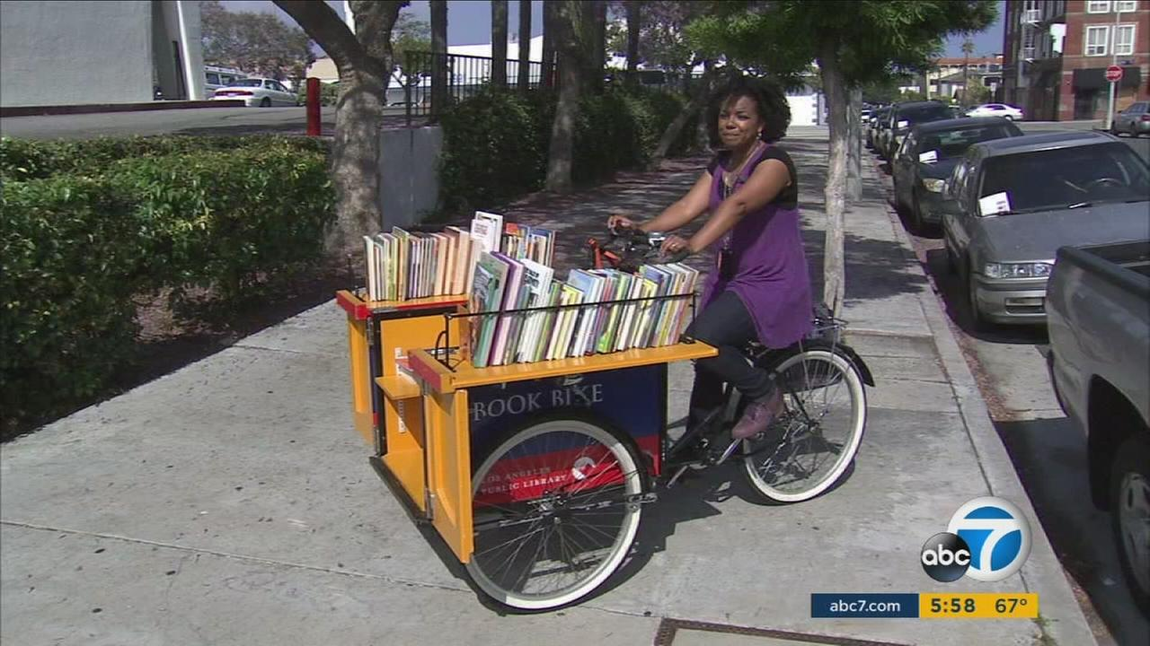 A librarian in San Pedro is using a bike as her library as part of her mission to get more young children to read.