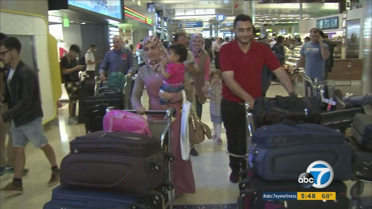 A Syrian family who came to Los Angeles under the states refugee program walk through LAX on Thursday, May 26, 2016.