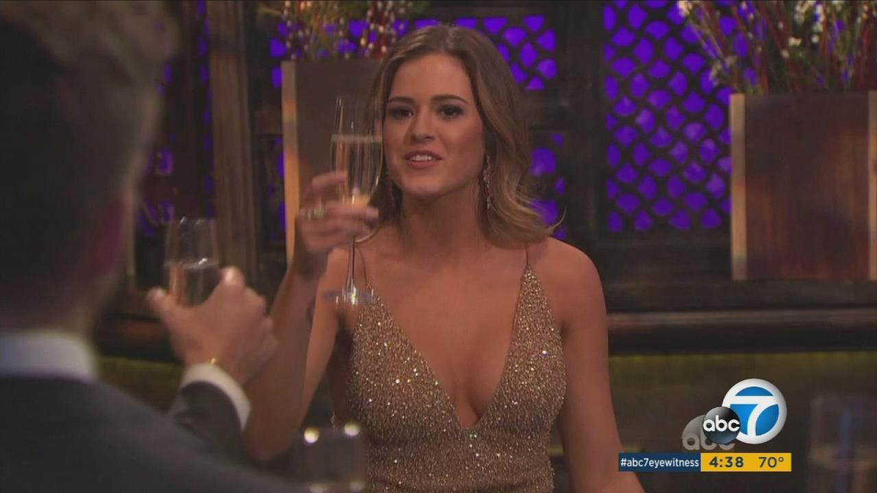 JoJo Fletcher holds a glass in the first episode of season 12.